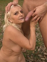 Sexy granny Szandra straddles while a guy rams his shaft into her wrinkled twat live