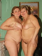 Mature lesbian plumpers Anna and Yolanda both get naked and tease each others fat cooters