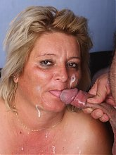 Cute granny Sussana joins a younger man on the couch and lures him into fucking live