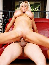 Tia Gunn exposes her pair of incredibly huge tits while she works wonders on a cock