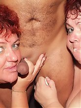 Louise and Mindy are hefty older gals working together and draining cum off a cock